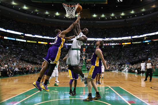 Kevin Garnett #5 of the Boston Celtics attempts a shot against Ron Artest #37 and Pau Gasol #16 of the Los Angeles Lakers in Game Three of the 2010 NBA Finals