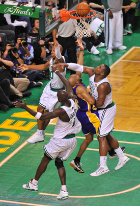 Derek Fisher #2 of the Los Angeles Lakers lays the ball in the basket against Glen Davis #11 of the Boston Celtics in Game Three of the 2010 NBA Finals